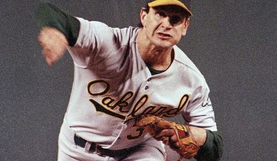 Oakland Athletics pitcher Bob Welch pitches against the Boston Red Sox in the first inning of game two of the American League Championship Series, on Sunday, Oct. 7, 1990 at Fenway Park in Boston. (AP Photo/Bill Waugh)