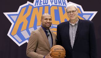 New York Knicks president Phil Jackson, right, poses with Derek Fisher during a news conference in Tarrytown, N.Y., Tuesday, June 10, 2014. The Knicks hired Fisher as their new coach on Tuesday, with Jackson turning to one of his trustiest former players. (AP Photo/Seth Wenig)