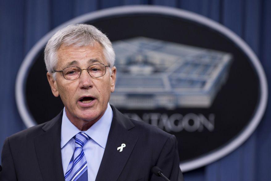 ** FILE ** In this May 1, 2014, file photo, Defense Secretary Chuck Hagel speaks to reporters at the Pentagon. (AP Photo/Manuel Balce Ceneta)
