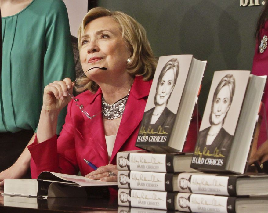"HiIlary Rodham Clinton listens before signing a copy of her book on Tuesday June 10, 2014, at Barnes and Noble bookstore in New York.  Clinton said Tuesday that she and former President Bill Clinton ""fully appreciate how hard life is for so many Americans,"" seeking to refine remarks she made about the pair being broke when they left the White House while on a high-profile media tour for a new book.  (AP Photo/Bebeto Matthews)"