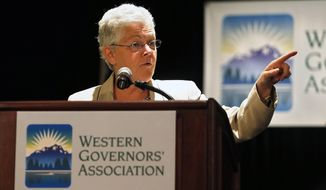 EPA Administrator Gina McCarthy delivers a keynote speech during the annual Western Governors' Association Meeting, at the Broadmoor Hotel in Colorado Springs, Tuesday, June 10, 2014. The head of the Environmental Protection Agency promoted currently proposed clean power plant rules to Western governors Tuesday, framing the plan as a way to deal with destructive wildfires and floods that have ravaged the region in recent years. (AP Photo/Brennan Linsley)