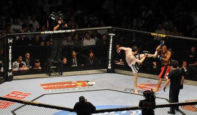 Tamdan McCrory throws a kick at John Howard during UFC 101. (Peter Lockley/The Washington Times)