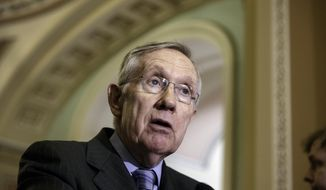 Senate Majority Leader Harry Reid of Nev. speaks to reporters on Capitol Hill in Washington, Tuesday, June 10, 2014, after a Democratic caucus lunch. Responding to the public outcry over lax care at Veterans Affairs health facilities, leaders of both parties plan debate soon on a bill to help vets waiting for months to get medical appointments. The House of Representatives advanced a VA reform bill today that passed 421-0.    (AP Photo/J. Scott Applewhite)