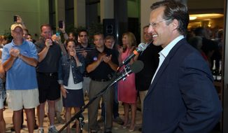 "Dave Brat speaks to supporters Tuesday after defeating Republican Congressman Eric Cantor in Tuesday's Republican primary for the 7th Congressional District in Virginia. Mr. Brat, who called his win ""a miracle"" was not ready to discuss policy with the press Wednesday. (Associated Press)"