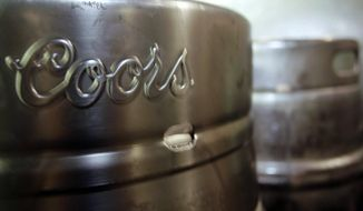 In this Oct. 9, 2007, file photo, barrels of Coors beer stand at Coors Field in Denver. (AP Photo/David Zalubowski, File)