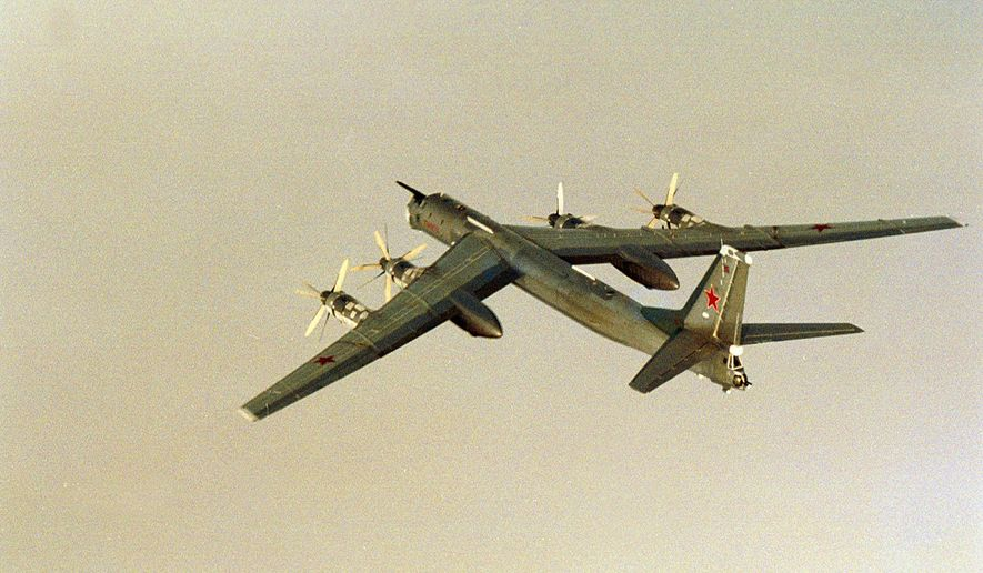 In this image made available by 331/332 Squadron of the Norwegian Air Force a Russian TU-95 Bear H flies over International waters off the coast of Norway on Friday Aug. 17, 2007. Eleven Russian military planes exercised West of Norway on Friday in the biggest show of Russian air power in the Norwegian Sea since the early 1990s, a military official said. The planes included strategic bombers, airborne early warning aircraft, fighter jets and refueling planes, said Brig. Gen. Ole Asak, chief of the Norwegian Joint Air Operations Center. (AP Photo by 331/332-Squadron of the Norwegian Air Force/Scanpix, HO) ** NORWAY OUT **