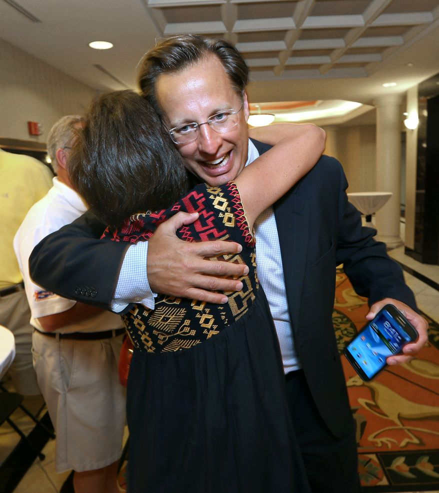 Dave Brat is congratulated by a supporter after defeating Republican Congressman Eric Cantor in the Republican primary for the 7th Congressional District in Virginia on Tuesday, June 10, 2014 in Henrico, Va.  Less than 24 hours after Majority Leader Eric Cantor's stunning primary defeat, House Republicans are jockeying for leadership positions. Officials say Rep. Kevin McCarthy of California is telling fellow Republicans he plans to run to succeed Cantor, and Rep. Pete Sessions of Texas is also signaling he's interested.   (AP Photo/Richmond Times-Dispatch, P. Kevin Morley)