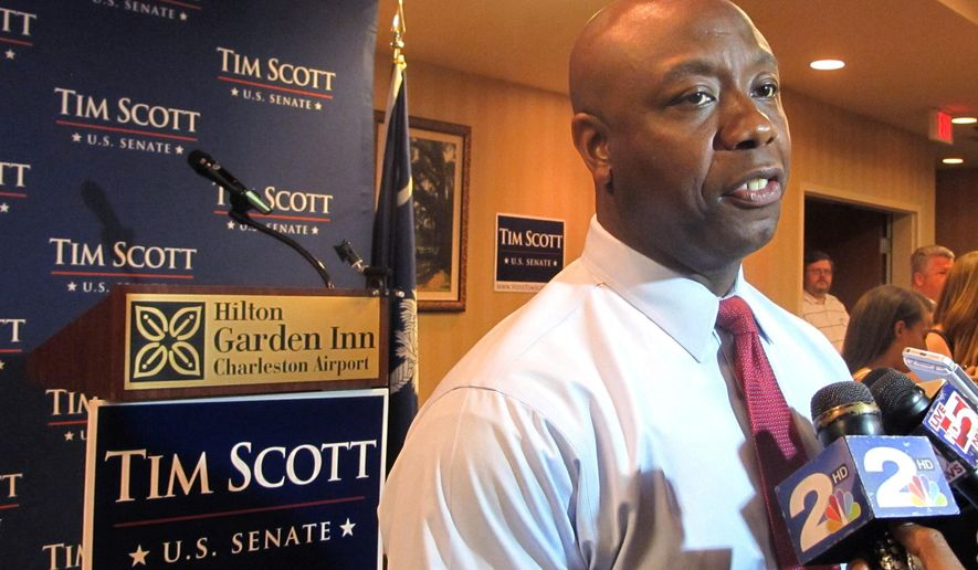 South Carolina Republican Sen. Tim Scott speaks with reporters in North Charleston, S.C., on Tuesday, June 10, 2014, after winning the GOP primary with over 90 percent of the vote. (AP Photo/Bruce Smith)