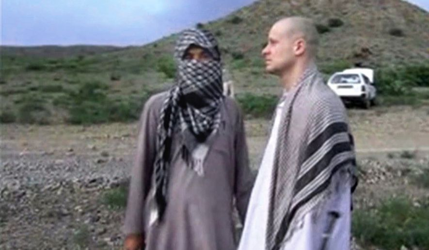 """FILE - In this file image taken from video obtained from Voice Of Jihad Website, which has been authenticated based on its contents and other AP reporting, Sgt. Bowe Bergdahl, right, stands with a Taliban fighter in eastern Afghanistan. Bergdahl was freed in a swap in which the U.S. freed five Taliban detainees, a diplomatic victory for the insurgent group. In a belt from Iraq to Pakistan, militants scored a series of successes the past weeks, a sign of their continued power 13 years into the U.S. """"war on terrorism."""" (AP Photo/Voice Of Jihad Website via AP video, File)"""