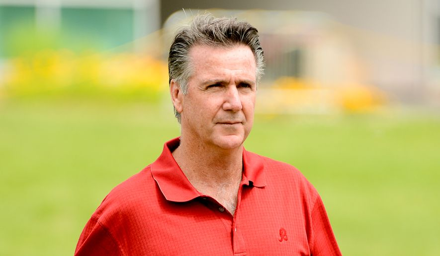 Washington Redskins General Manager Bruce Allen walks out to watch organized team activities at Redskins Park, Ashburn, Va., Wednesday, June 11, 2014. (Andrew Harnik/The Washington Times)
