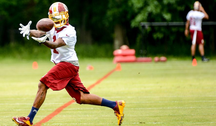 Washington Redskins wide receivers DeSean Jackson (1) hauls in a pass during organized team activities at Redskins Park, Ashburn, Va., Wednesday, June 11, 2014. (Andrew Harnik/The Washington Times)