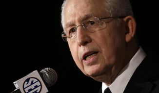 FILE - In this July 16, 2013, file photo, Southeastern Conference Commissioner Mike Slive talks with reporters during the SEC football media days in Hoover, Ala. (AP Photo/Dave Martin, File)