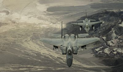 FILE PHOTO: Col. John York pilots an F-15 Eagle ahead of Lt. Col. Sean Navin, who flies an F-16 Falcon on its final mission for the 144th Fighter Wing, California Air National Guard. The F-16s have been transferred to the 162nd Fighter Wing in Tucson, Ariz., as a result of the 144th Fighter Wing receiving the F-15 Eagle as their new airframe. York is the 144th Operations Group commander. Navin is the commander of the 194th Fighter Squadron. (U.S. Air Force photo/Master Sgt. David J. Loeffler)