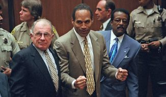 On Oct. 3, 1995, O.J. Simpson (center) was found not guilty of murdering his ex-wife Nicole Brown Simpson and her friend Ronald Goldman after a much publicized, televised trial that mesmerized the nation.