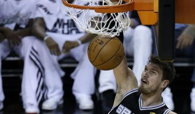 San Antonio Spurs center Tiago Splitter (22) dunks against the Miami Heat in the first half in Game 4 of the NBA basketball finals, Thursday, June 12, 2014, in Miami. (AP Photo/Wilfredo Lee)