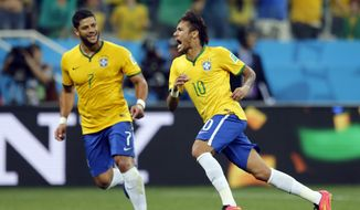Brazil's Neymar, right, celebrates with teammate Hulk after scoring during the group A World Cup soccer match against Croatia in the opening game of the tournament at Itaquerao Stadium in Sao Paulo, Brazil, Thursday, June 12, 2014. (AP Photo/Frank Augstein)