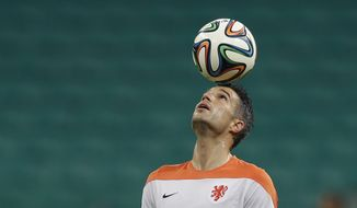 Netherlands' Robin van Persie controls the ball during an official training session the day before the group B World Cup soccer match between Spain and the Netherlands at the Arena Ponte Nova in Salvador, Brazil, Thursday, June 12, 2014.  (AP Photo/Natacha Pisarenko)
