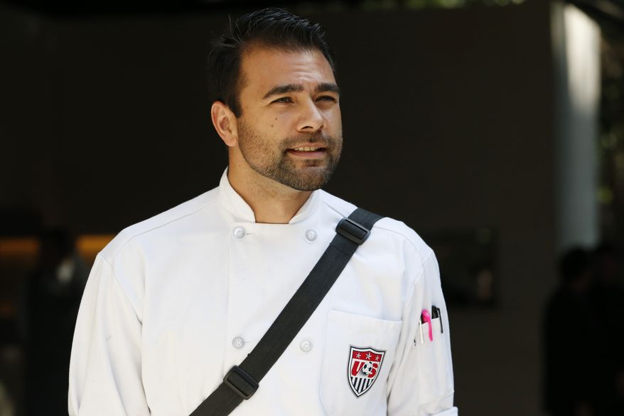 United States men's soccer team chef Bryson Billapando waits for the team to arrive at the team hotel in Sao Paulo, Brazil, Monday, June 9, 2014. The U.S. will play in group G of the 2014 soccer World Cup. (AP Photo/Julio Cortez)