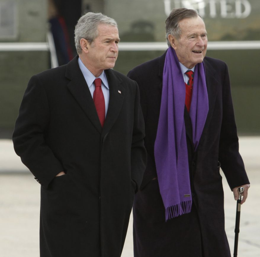 FILE - This Dec. 26, 2008 file photo shows then-President George W. Bush walking with his father, former President George H.W. Bush, at Andrews Air Force Base, Md. Turns out even former presidents can fall prey to hackers. A mysterious email hacker apparently accessed private photos and messages sent between members of the Bush family, including both retired commanders in chief. The Secret Service is investigating the breach, which appeared to yield little more than a few snapshots and some family discussions. But the incident illustrated how easily hackers can pry into private lives, even those of one of the nation's most prominent and closely guarded political clans. (AP Photo/Evan Vucci, File)