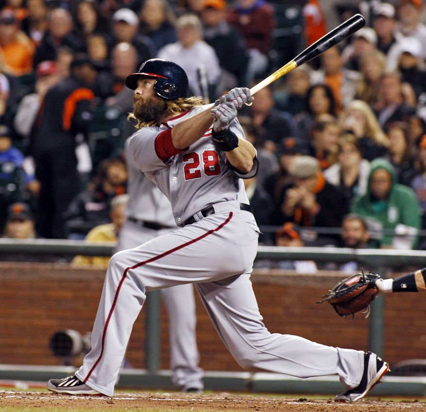Washington Nationals' Jason Werth hits a home run against the San Francisco Giants during the fifth inning of a baseball game, Wednesday, June 11, 2014, in San Francisco. (AP Photo/George Nikitin)