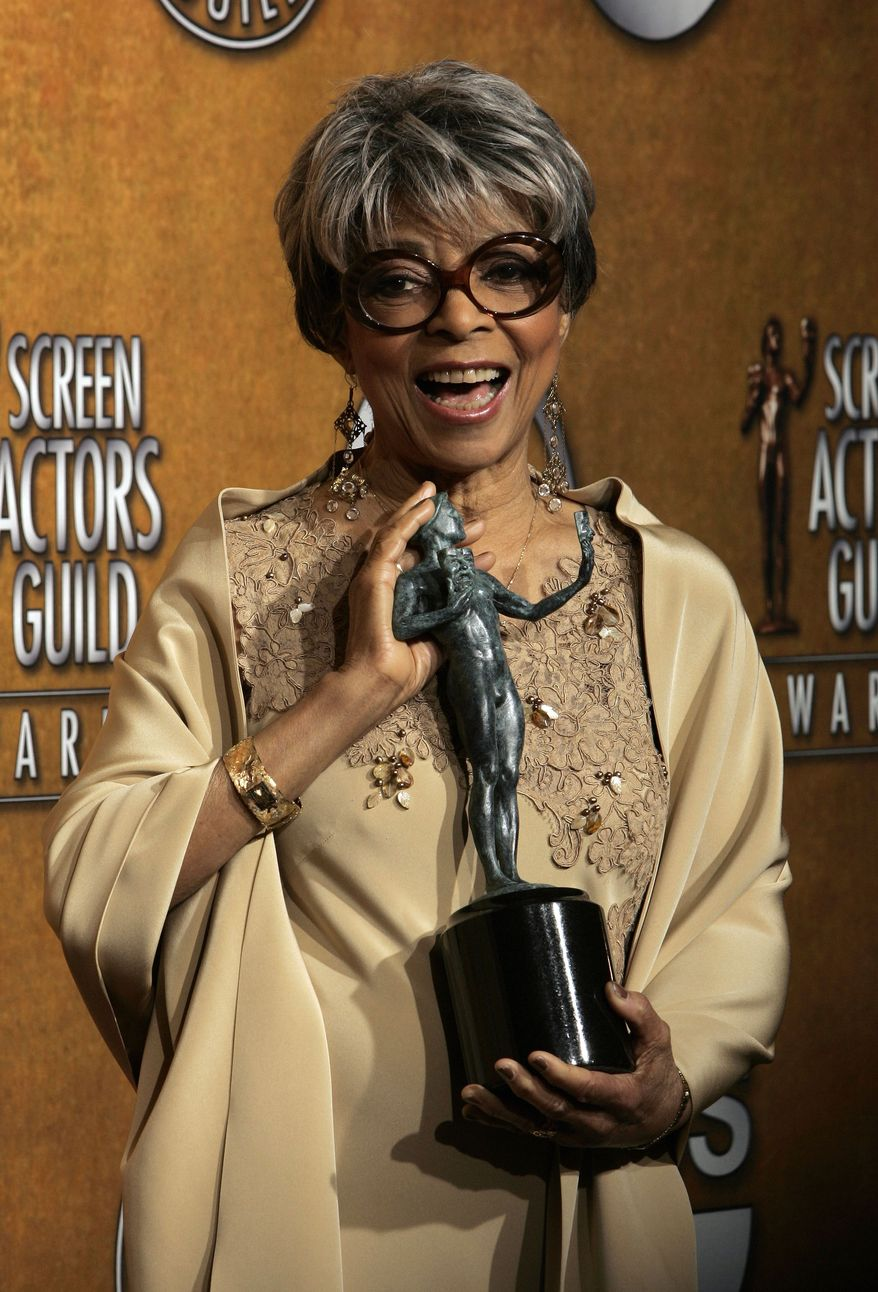 """FILE - In this Jan. 27, 2008 file photo, Ruby Dee poses with the award for outstanding performance by a female actor in a supporting role for her work in """"American Gangster"""" at the 14th Annual Screen Actors Guild Awards, in Los Angeles. Dee, an acclaimed actor and civil rights activist whose versatile career spanned stage, radio television and film, has died at age 91, according to her daughter. Nora Davis Day told The Associated Press on Thursday, June 12, 2014, that her mother died at home at New Rochelle, New York, on Wednesday night.   (AP Photo/Reed Saxon, file)"""
