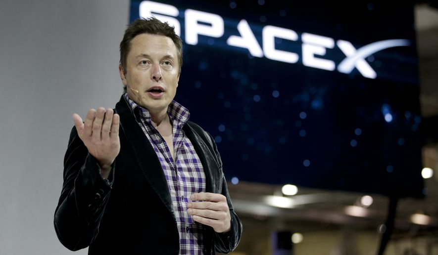 FILE - In this Thursday, May 29, 2014, file photo, Elon Musk, CEO and CTO of SpaceX, introduces the SpaceX Dragon V2 spaceship at the SpaceX headquarters on, in Hawthorne, Calif.  Tesla Motors is opening access to its patents to accelerate electric vehicle development. Musk says the company will share several hundred patents and won't sue those who use them. (AP Photo/Jae C. Hong, File)