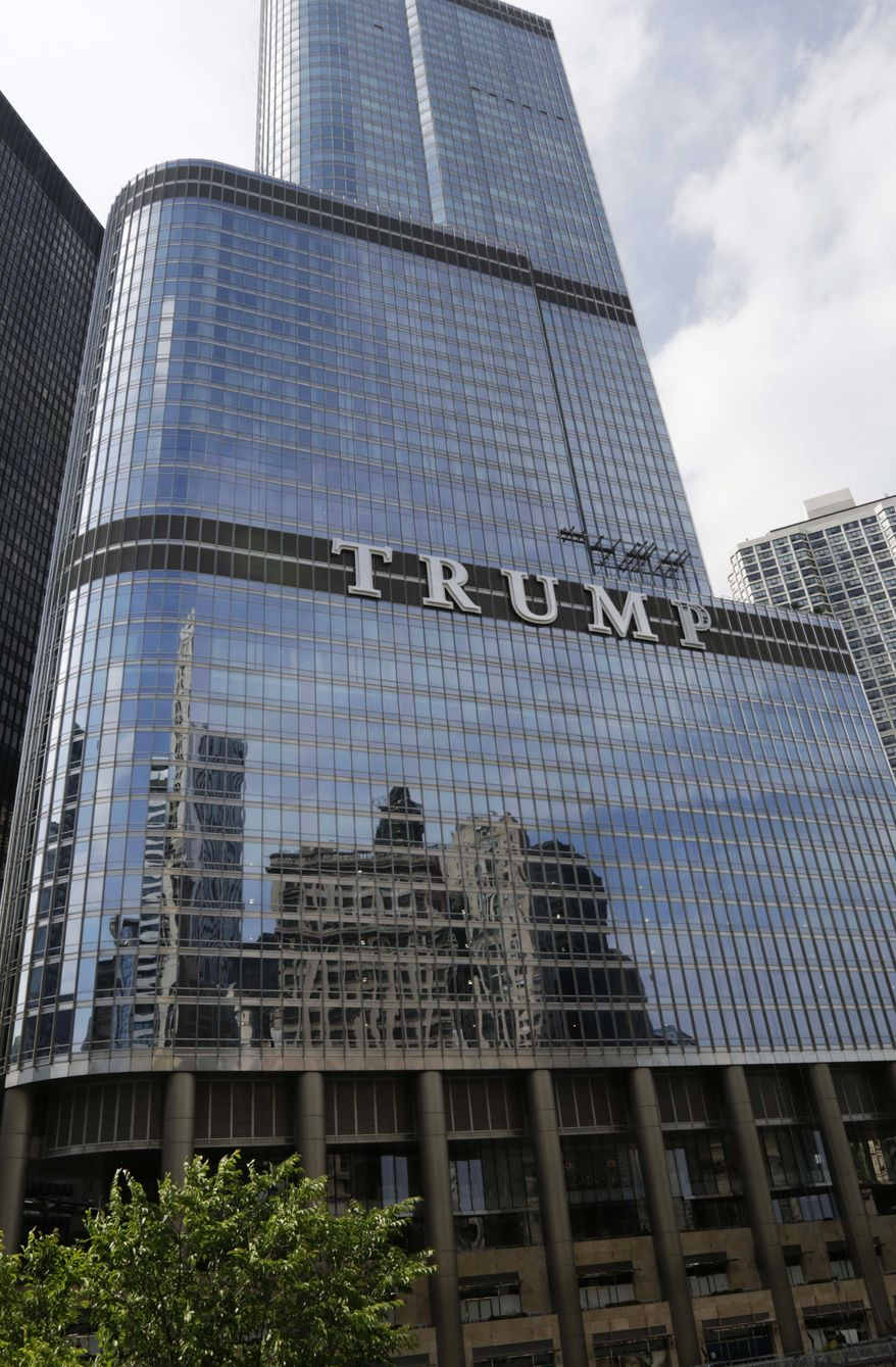 Newly installed 20-foot-tall letters spelling out T-R-U-M-P stand on the side real estate billionaire Donald trump's skyscraper in Chicago, Thursday, June 12, 2014. The letters have triggered a war of words between Trump and Chicago Mayor Rahm Emanuel.(AP Photo/Stacy Thacker)