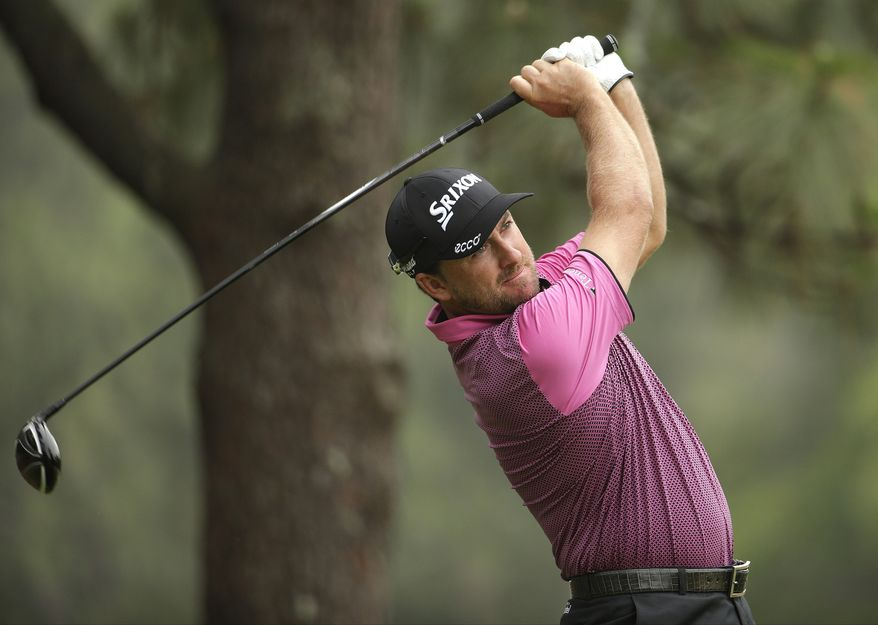 Graeme McDowell, of Northern Ireland, watches his tee shot on the second hole during the first  round of the U.S. Open golf tournament in Pinehurst, N.C., Thursday, June 12, 2014. (AP Photo/Chuck Burton)