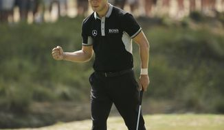 Martin Kaymer, of Germany, reacts to his birdie on the 16th hole during the second round of the U.S. Open golf tournament in Pinehurst, N.C., Friday, June 13, 2014. (AP Photo/Chuck Burton)