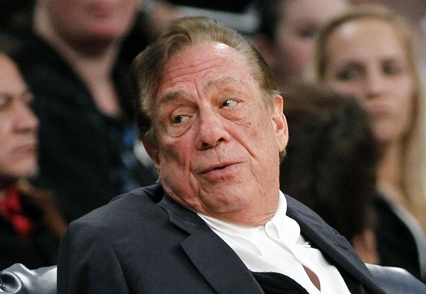 ** FILE ** In this Dec. 19, 2011, file photo, Los Angeles Clippers owner Donald Sterling gestures while watching the Clippers play the Los Angeles Lakers during an NBA preseason basketball game in Los Angeles. (AP Photo/Danny Moloshok, File)