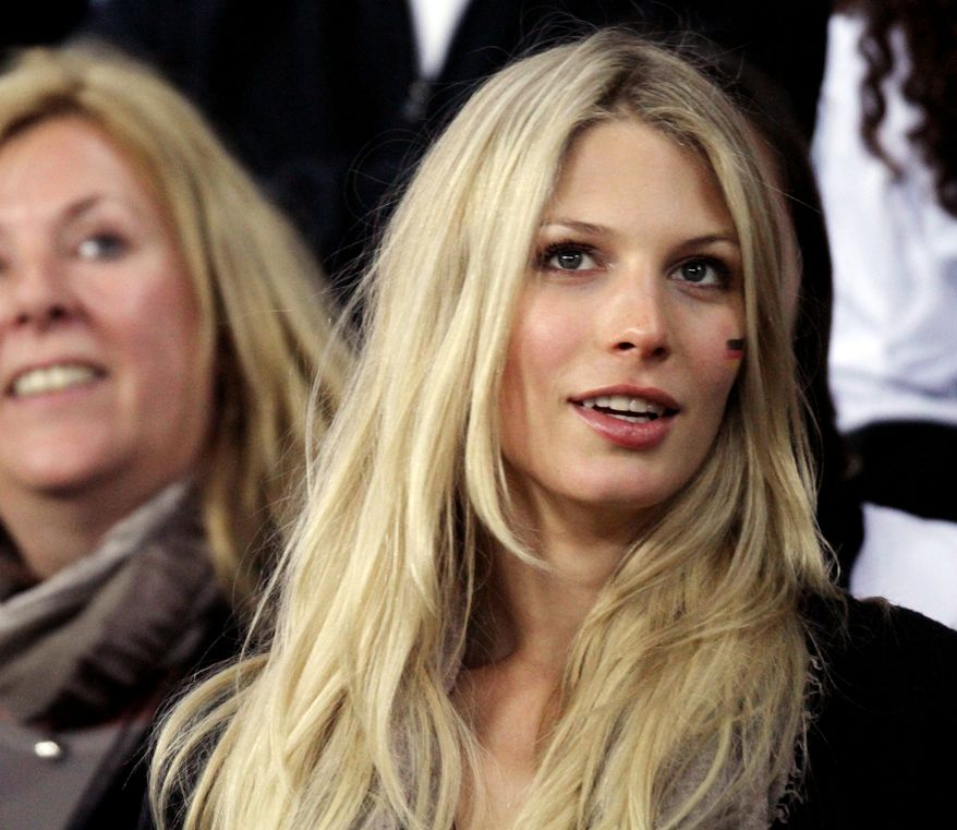 Sarah Brandner, right, girlfriend of Germany's Bastian Schweinsteiger, and Daniela Loew, wife of Germany head coach Joachim Loew, attend the World Cup third-place soccer match between Germany and Uruguay at Nelson Mandela Bay Stadium in Port Elizabeth, South Africa, Saturday, July 10, 2010.  (AP Photo/Gero Breloer)
