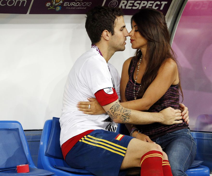 Spain's Cesc Fabregas kisses his girlfriend Daniella Semaan after Spain won the Euro 2012 soccer championship final  between Spain and Italy in Kiev, Ukraine, Monday, July 2, 2012.  (AP Photo/Michael Sohn)