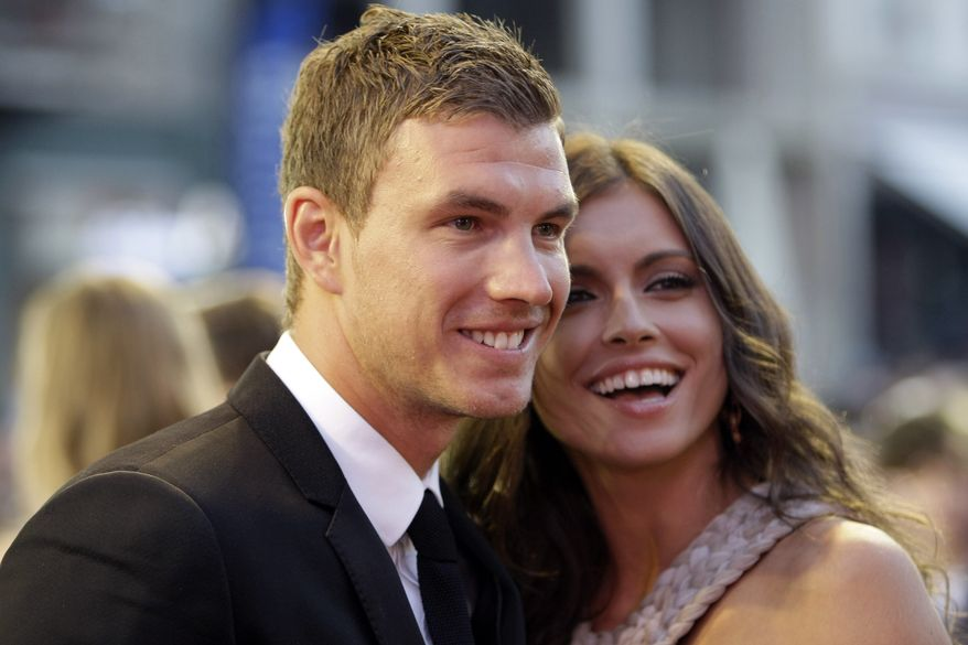 """Bosnian soccer player Edin Dzeko with model Amra Silajdzic smile during the opening ceremony of the 18th Sarajevo Film Festival, in Sarajevo, Bosnia, on Friday, July 6, 2012. The 18th Sarajevo Film Festival is set to kick off with Aida Begic's regional premiere of """"Children of Sarajevo,"""" which recently won the top prize in the Cannes Film Festival's sidebar competition Un Certain Regard. Over the next nine days some 100,000 moviegoers are expected to see some of the festival's 210 films from 57 countries. (AP Photo/Amel Emric)"""