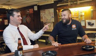In this photo taken on Thursday, June 12, 2014, former Marine Sgt. Ben Colin, left, and Army veteran Tom Griswald talk about their experiences serving in Iraq at the Sheehy-Palmer VFW Post 6776 in Albany, N.Y. (AP Photo/Hans Pennink) ** FILE **