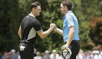 Martin Kaymer, of Germany, left, shakes hands with Keegan Bradley after the second round of the U.S. Open golf tournament in Pinehurst, N.C., Friday, June 13, 2014. (AP Photo/Chuck Burton)
