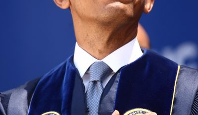 President Barack Obama puts his hand over his heart during the pledge of allegiance before he gives the commencement speech for the University of California, Irvine at the Angel Stadium in Anaheim, Calif., Saturday, June 14,  2014.    (AP Photo/Los Angeles Times, Genaro Molina, Pool)