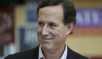 Former Pennsylvania Sen. Rick Santorum speaks to delegates during the Iowa State Republican Convention, Saturday, June 14, 2014, in Des Moines, Iowa. (AP Photo/Charlie Neibergall)