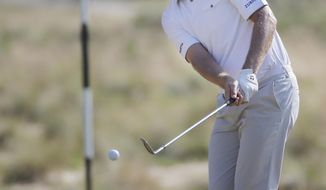 Justin Rose, of England, chips to the green on the 12th hole during the final round of the U.S. Open golf tournament in Pinehurst, N.C., Sunday, June 15, 2014. (AP Photo/Eric Gay)