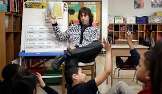 Richard Burton works with his second-grade class on telling the difference between imagined and real stories at George Buck Elementary School in Indianapolis. Indiana was one of the first states to adopt the Common Core education standards and also the first to abandon the benchmarks. (AP Photo/AJ Mast)