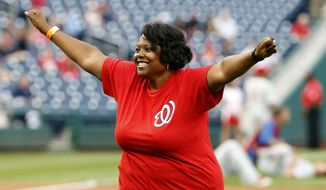 **FILE** Kaya Henderson, chancellor of Washington public schools, reacts after throwing out a ceremonial first pitch, before a baseball game between the Washington Nationals and the Philadelphia Phillies at Nationals Park Wednesday, June 4, 2014, in Washington. (AP Photo/Alex Brandon)