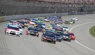 Drivers Kevin Harvick, left, and Jeff Gordon lead the pack through the first turn during the NASCAR Quicken Loans 400 auto race at Michigan International Speedway in Brooklyn, Mich., Sunday, June 15, 2014. (AP Photo/Bob Brodbeck)