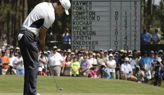 Martin Kaymer, of Germany, watches his putt on the first hole during the final round of the U.S. Open golf tournament in Pinehurst, N.C., Sunday, June 15, 2014. (AP Photo/Charlie Riedel)