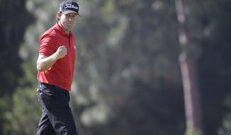 Erik Compton reacts to his birdie on the eighth hole during the final round of the U.S. Open golf tournament in Pinehurst, N.C., Sunday, June 15, 2014. (AP Photo/David Goldman)