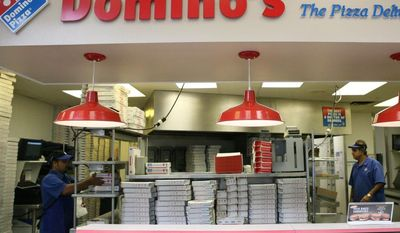 ** FILE ** Sohel Islar (left) and Malak Khan work behind the counter at a Domino's Pizza store in Arlington in 2008. (The Washington Times)