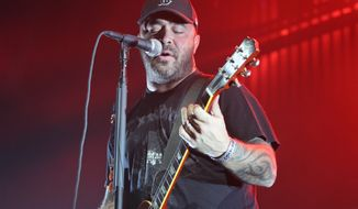 News reports on the viral video of Staind singer Aaron Lewis' rage against concertgoers rarely mentioned his anti-violence stance or the charity he co-founded in 2010 with his wife. (associated press)