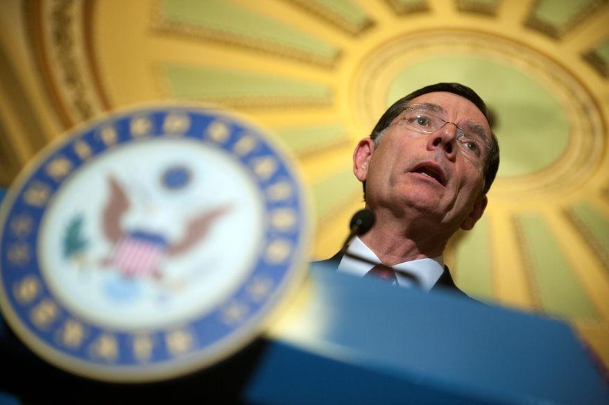 "Sen. John Barrasso, Wyoming Republican, has called Attorney General Eric H. Holder Jr. an Obama ""puppet."" (Associated Press)"