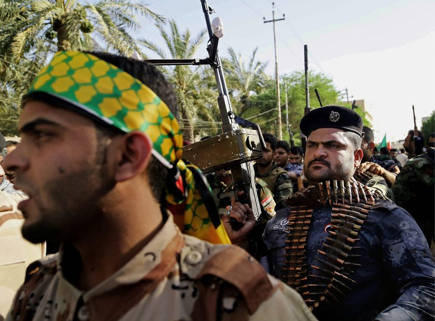Shiite tribal fighters raise their weapons and chant slogans against the al-Qaida-inspired Islamic State of Iraq and the Levant (ISIL) in Basra, Iraq's second-largest city, 340 miles (550 kilometers) southeast of Baghdad, Iraq, Monday, As the U.S. masses air power on Iraq's doorstep, analysts are warning that missiles and bombs will have limited impact on Islamic militants unless the Iraqi army stops running and starts fighting. (AP Photo/ Nabil Al-Jurani)