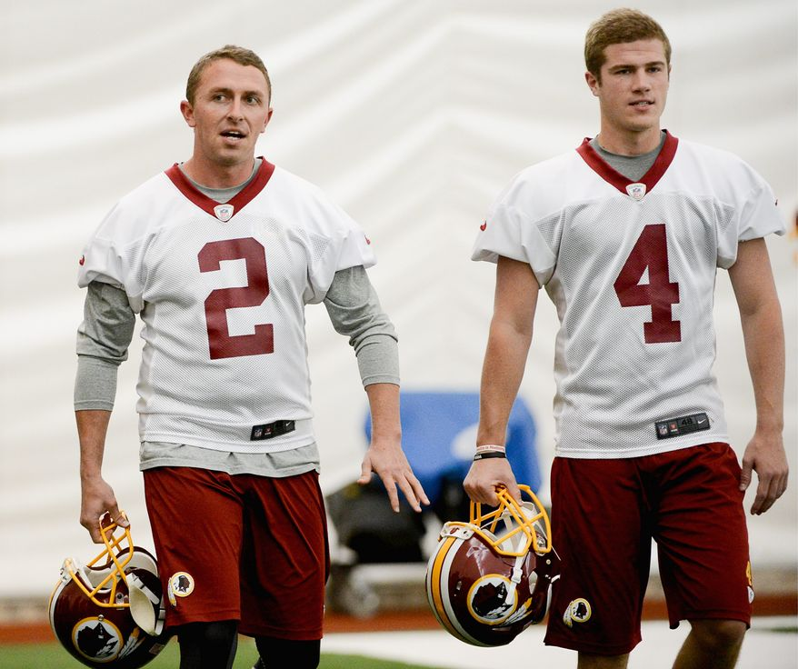 Kai Forbath, left, is the Redskins' incumbent kicker, but he has been giving pointers to rookie Zach Hocker, a seventh-round pick in 2014 who could end up taking his job. (Andrew Harnik/The Washington Times)