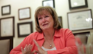 Wendy Kozma of Novi, Mich., talks about her mentally disabled daughter Jodi Renee Kozma, 25, on Thursday June 12, 2014, at the law offices of Deborah Gordon in Bloomfield Hills, Mich. The Kozmas are suing Wal-Mart and police after their daughter was stopped for suspected shoplifting at a Walmart in Livonia, Mich. Kozma says her 25-year-old daughter, Jodi, who has the mental capacity of an 8-year-old, now is terrified of police after being handcuffed and questioned  in 2012. Records show she didn't steal anything. (AP Photo/Detroit Free Press, Ryan Garza)  DETROIT NEWS OUT;  NO SALES