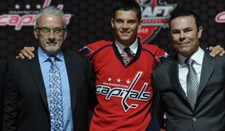 **FILE** Andre Burakovsky, a winger, stands with Washington Capitals scouting director Ross Mahoney (left) and coach Adam Oates (right) after being chosen 23rd overall in the first round of the NHL hockey draft, Sunday, June 30, 2013, in Newark, N.J. (AP Photo/Bill Kostroun)